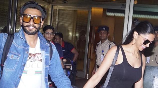 Newlyweds Ranveer Singh and Deepika Padukone seen at Mumbai's airport.(IANS)