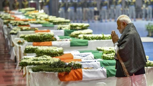 Prime Minister Narendra Modi pays tribute to the martyred CRPF jawans, who lost their lives in Thursday's Pulwama terror attack, after their mortal remains were brought at AFS Palam in New Delhi, Feb 15.(PTI)