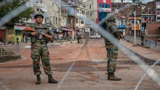 Army personnel stand guard at Gujjar Nagar area during a curfew, imposed on the third day after the clash between two communities over the protest against the Pulwama terror attack, in Jammu, Sunday, Feb. 17, 2019.(PTI file photo)