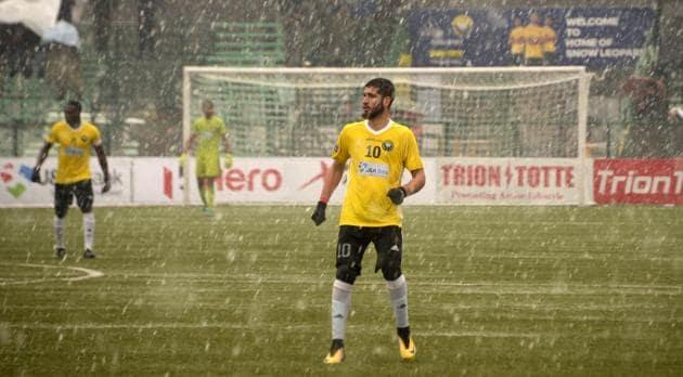 Real Kashmir's Danish Farooq looks on amid snowfall during their I-League club football match against Gokulam Kerala FC.(AFP)