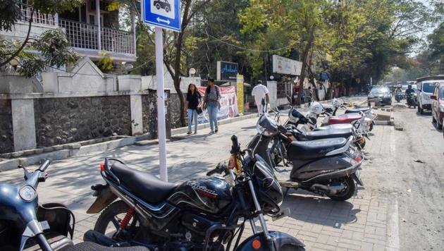 With poor police surveillance and legal action, the footpaths reserved for pedestrians along major city roads have become illegal parking spots for vehicles. (In pic) Vehicles parked on footpath at FC road.(HT/PHOTO)