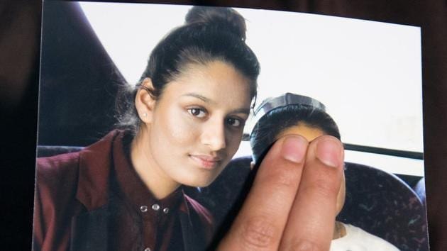Renu Begum, sister of teenage British girl Shamima Begum, holds a photo of her sister as she makes an appeal for her to return home at Scotland Yard, in London.(REUTERS)