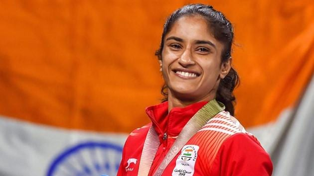 Vinesh Phogat poses for pictures during the medal ceremony of WFS50kg wrestling Nordic at the Commonwealth Games 2018.(PTI)