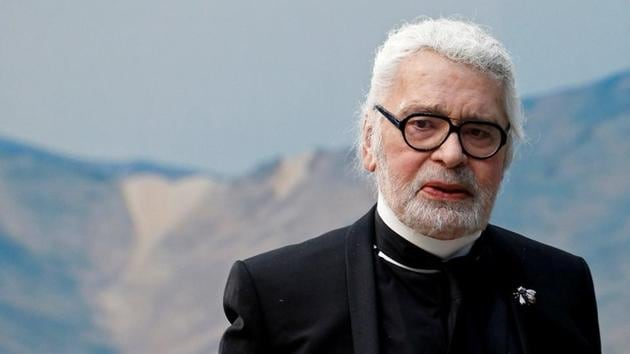 FILE PHOTO: German designer Karl Lagerfeld appears at the end of his Spring/Summer 2019 women's ready-to-wear collection show for fashion house Chanel during Paris Fashion Week in Paris, France, October 2, 2018. REUTERS/Stephane Mahe/File Photo(REUTERS)