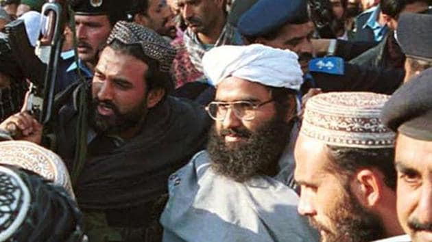 Leader of JeM group Masood Azhar, center wearing glasses and white turban, in Islamabad on January 27, 2000.(AP File Photo)