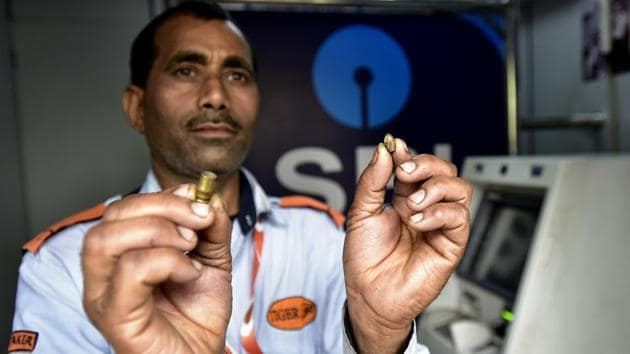 SBI ATM security guard shows bullets that were fired outside the ATM at Kendriya Vihar 2 society in Sector 82, in Noida, on Tuesday, February 19, 2019.(Virendra Singh Gosain/ HT Photo)
