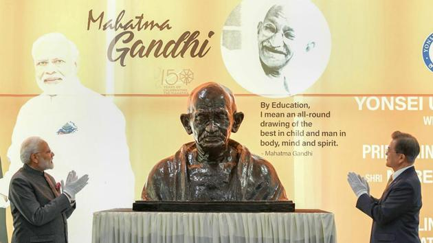 <p>Prime Minister Narendra Modi and South Korean President Moon Jae-in unveil the bust of Mahatma Gandhi at the Yonsei University, in Seoul. During Modi&rsquo;s...