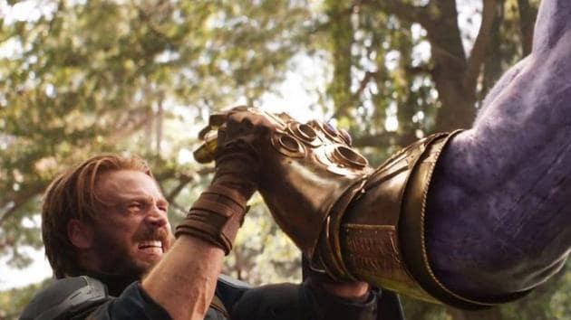 Chris Evans as Captain America, fighting Thanos in Avengers: Infinity War.
