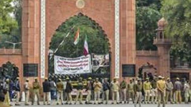 Aligarh: Police personnel deployed on the campus of Aligarh Muslim University in the view of protests after some students were booked on alleged sedition charges, in Aligarh, Friday, Feb 15, 2019. (PTI Photo) (PTI2_15_2019_000168B)(PTI)