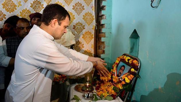 Congress president Rahul Gandhi offers tribute to slain CRPF jawan Pradeep Kumar, who lost his life in the Pulwama terror attack, at his residence in Shamli.(PTI)