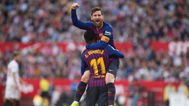 Barcelona captain forward Lionel Messi celebrates his second goal with Ousmane Dembele.(AFP)