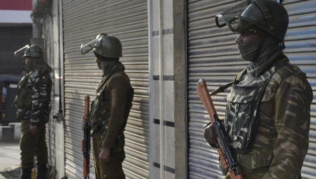 Central Reserve Police Force (CRPF) personnel stand guard outside a closed market area during a shutdown in central Srinagar.(ANI)