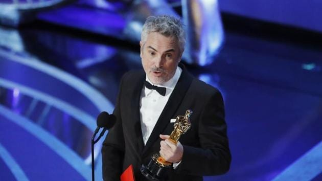 91st Academy Awards: Alfonso Cuaron accepts the Foreign Language Film award for Roma.(REUTERS)