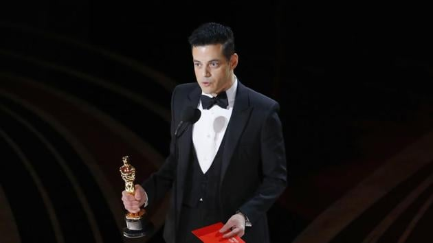 """Rami Malek reacts while holding his Oscar after accepting the Best Actor award for his role in """"Bohemian Rhapsody"""".(REUTERS)"""