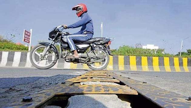 The officials said the company has initiated repair work. They said that changes are being made in the design as two-wheeler riders were able to drive on the wrong side by placing the wheels between two spikes.(Sunil Ghosh /HT Photo)