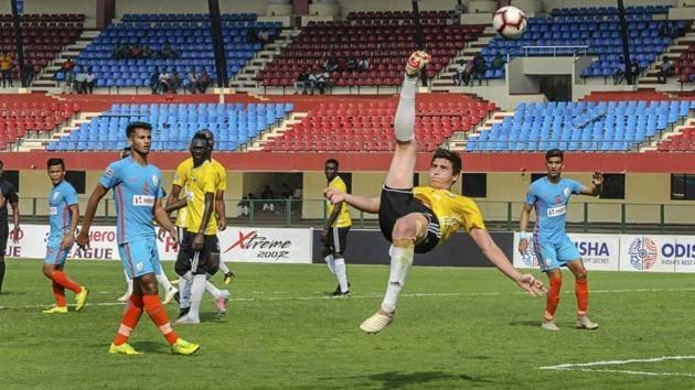 Real Kashmir's Mason Robertson (yellow) attempts an overhead kick against team Indian Arrows.(PTI)