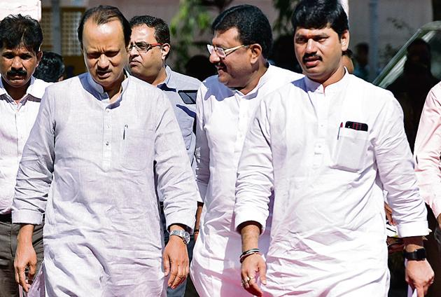 NCP leaders Ajit Pawar and Dhananjay Munde on the first day of the budget session at Vidhan Bhavan on Monday.(Anshuman Poyrekar/HT Photo)