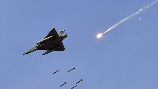 """File picture a Mirage 2000 fighter jet releases bombs during the IAF exercise named """"Vayu Shakti 2019"""" at the Air Force field firing range of Pokhran in Rajasthan.(PTI photo)"""