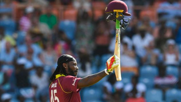 Chris Gayle of West Indies celebrates achieving 10,000 ODI runs during the 4th ODI between West Indies and England at Grenada National Cricket Stadium.(AFP)