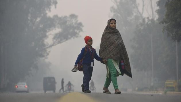 The disturbance made Wednesday the coldest late February day in at least seven years, IMD said, with day-time temperature dropping to 20 degrees Celsius, at least six degrees below normal.(Biplov Bhuyan/HT Photo)