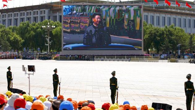 A screen displays Chinese President Xi Jinping reviewing the army at the Tiananmen Square, at the beginning of the military parade.(Reuters Photo)