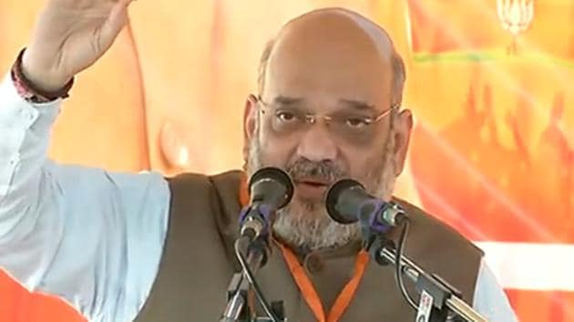 BJP president Amit Shah addressing party workers at Umaria, Madhya Pradesh before launching a bike rally on Saturday.(Photo: Twitter/@BJP4India)