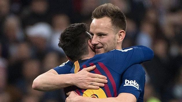 Barcelona's Argentinian forward Lionel Messi (L) celebrates with Barcelona's Croatian midfielder Ivan Rakitic at the end of the Spanish league football match.(AFP)