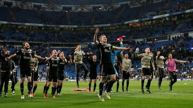 Ajax captain Matthijs de Ligt and team mates celebrate in front of their fans at the end of their Champions League match against Real Madrid on Tuesday.(REUTERS)