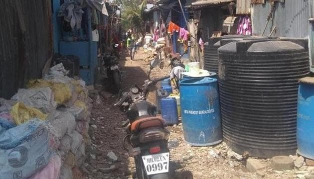 Being in a Coastal Regulatory Zone, Ganpat Patil Nagar in Mumbai's Dahisar is considered illegal, as a result of which the civic body has not provided residents with water and electricity. Many residents of the colony have decided to opt for NOTA in the upcoming Lok Sabha elections.(HT Photo)
