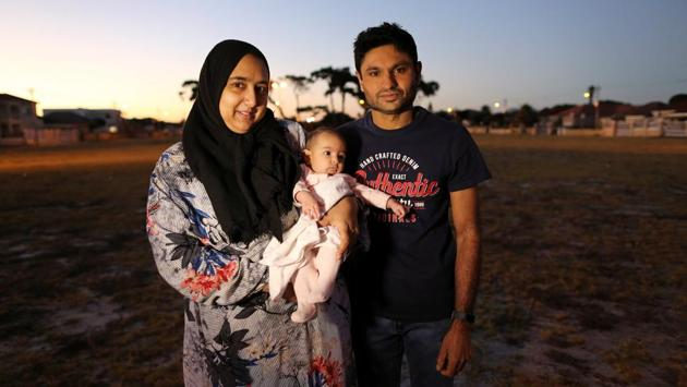 "Ferzanah Essack, a software developer, her husband and their 4.5-month-old baby Salma in Cape Town, South Africa. State law allows mothers four months of maternity leave although employers are not obliged to pay for it. Ferzanah said six to seven months would be more reasonable. Grandparents will now be taking care of Salma. ""We pay in love and kisses"", she said. ""With lots of love, because it's the grannies."" (Sumaya Hisham / REUTERS)"