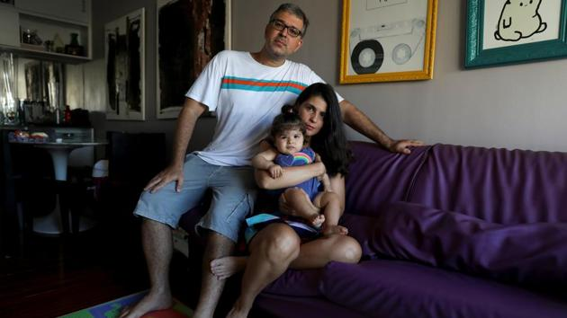 "Tatiana Barcellos, a civil servant, her eight-month-old daughter Alice, and her husband, on the day Tatiana resumed work, in Rio de Janeiro, Brazil. Statutory leave for mothers in the public sector is 120 to 180 days.""I feel anxious and worried that my absence will cause stress to my baby. I think mothers should have at least one year of maternity leave, considering the physical and emotional needs of babies in full development"", she said. (Pilar Olivares / REUTERS)"
