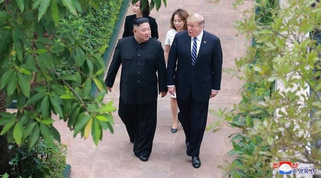North Korean leader Kim Jong Un and US President Donald Trump walking together at the Sofitel Legend Metropole hotel in Hanoi, February 2019.(AFP)