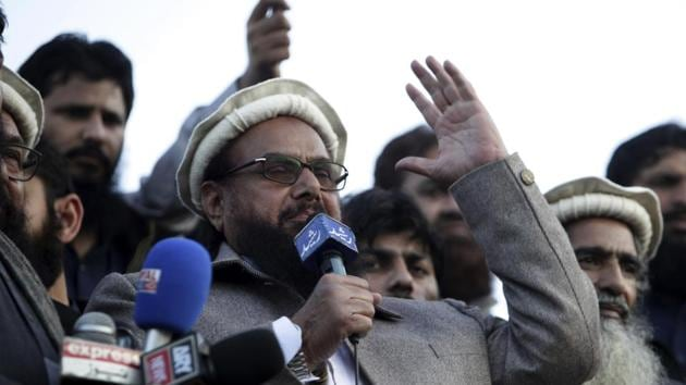 Hafiz Saeed, chief of Pakistani religious group Jamaat-ud-Dawa, addresses a rally for Kashmir Day in Lahore, Pakistan.(AP FILE PHOTO)