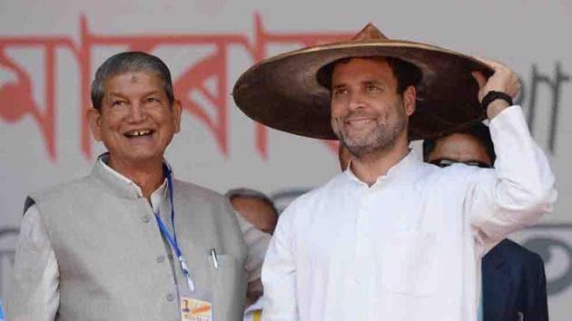Congress president Rahul Gandhi and former Uttarakhand chief minister Harish Rawat at a rally.(ANI)