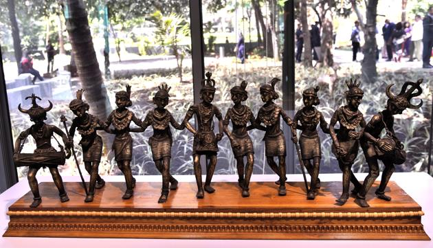 At the exhibition curated by children, a bronze composite of Madiya tribals from Chhattisgarh performing their traditional dance, Gaur, symbolises teamwork.(Anshuman Poyrekar / HT Photo)