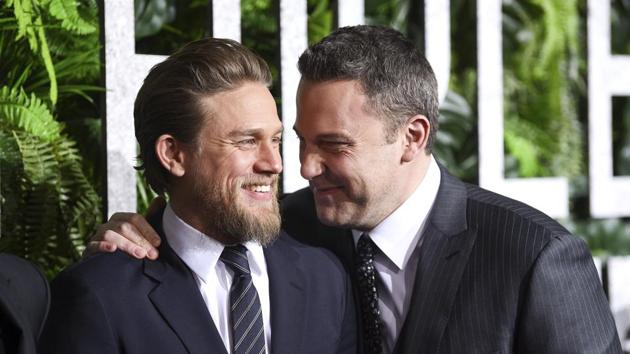 Actors Charlie Hunnam, left, and Ben Affleck share a laugh at the world premiere of Triple Frontier at Jazz at Lincoln Center.(Evan Agostini/Invision/AP)