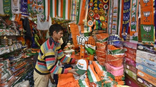 A shop with flags and other campaign material for different political parties in New Delhi's Sadar Bazar.(Raj K Raj/HT PHOTO)