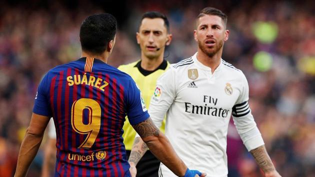 Barcelona's Luis Suarez and Real Madrid's Sergio Ramos react.(REUTERS)
