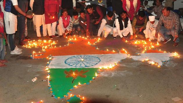 People light oil lamps to pay tribute to the martyrs of Pulwama terror attack and celebrate Indian Air Force's pre-emptive strike in Balakot, Feb 26(PTI)