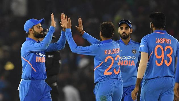 File image of Virat Kohli with the Indian bowlers(AFP)