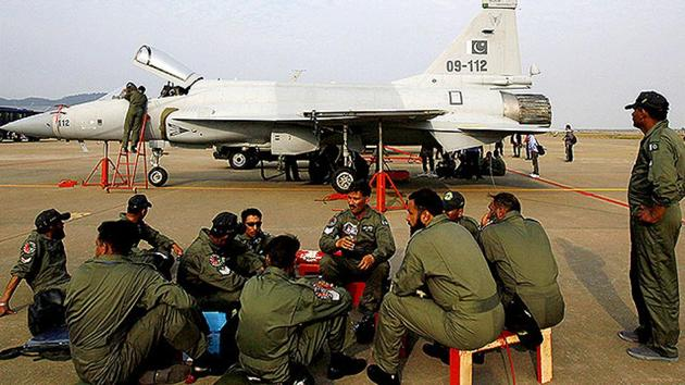 Pakistan Air Force personnel sit in front of their JF 17 jet fighter in Guangdong province, China.(AP File Photo/Representative image)