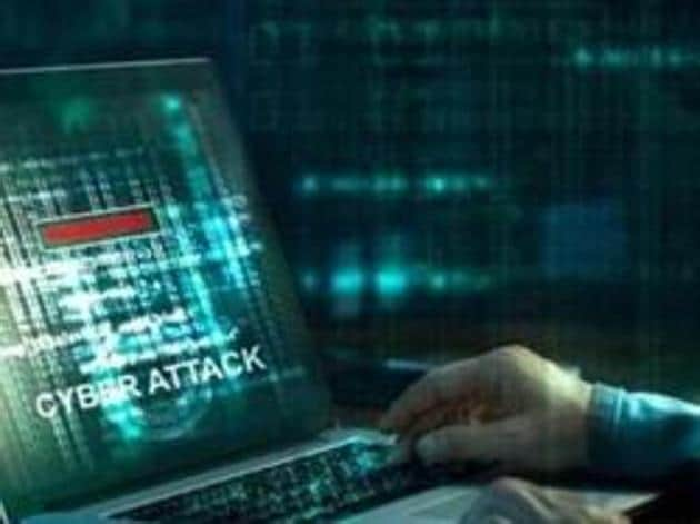 Computer hacker. Internet crime working on a code on laptop screen with dark digital background. Cyber attack in cyberspace concept(Getty Images/iStockphoto)