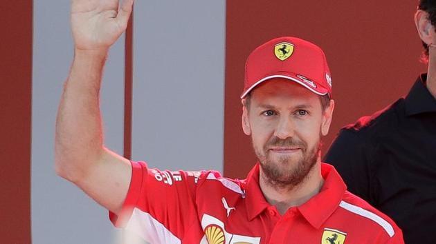 Ferrari driver Sebastian Vettel of Germany waves during the launch for the Australian Grand Prix in Melbourne, Australia, Wednesday.(AP)