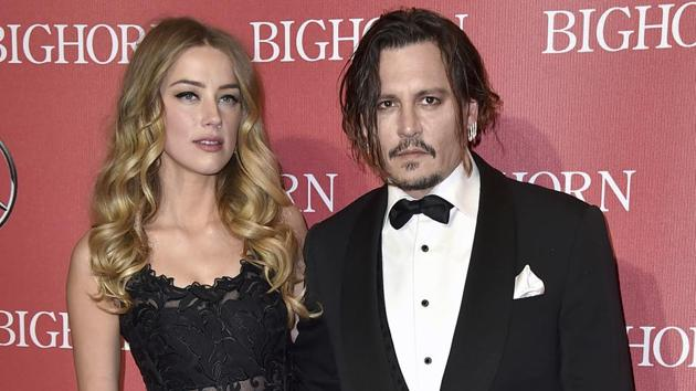 In this January 2, 2016, file photo, Amber Heard, left, and Johnny Depp arrive at the 27th annual Palm Springs International Film Festival Awards Gala in Palm Springs.(Jordan Strauss/Invision/AP)