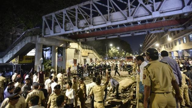 """Maharashtra Chief Minister Devendra Fadnavis has set a Friday evening deadline for the authorities to find what led to collapse of a foot-over bridge in Mumbai yesterday. Six people lost their lives in the incident. Many others were injured. Fadnavis, who visited the site said he has asked the authorities to """"fix primary responsibility"""" for the bridge collapse by """"this evening"""". (Kunal Patil / HT Photo)"""