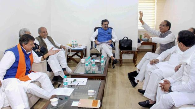 BJP State President Rakesh Singh (C), BJP National Vice President and former chief minister Shivraj Singh Chouhan (3rdR) and party leaders during a meeting, at BJP State headquarters in Bhopal. The BJP is mulling axing over 12 sitting MPs for the April-May Lok Sabha polls to tide over anti-incumbency, a party leader told news agency PTI on condition of anonymity. (PTI)