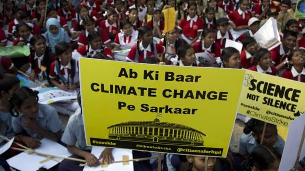 Indian students hold placards and participate in a climate protest in Hyderabad, March 15, 2019. Students in more than 80 countries and territories worldwide skipped class in protest over their governments' failure to act against global warming.(AP)