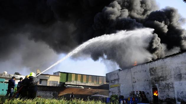 A major fire in Thinner factory, Industrial area,Phase 7 at Mohali on Friday.(HT Photo)