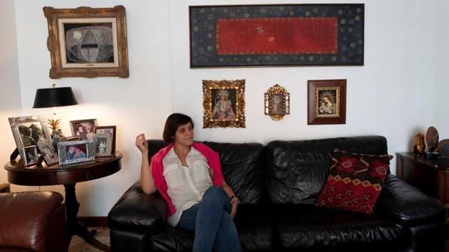 """Elias enjoys Venezuelan traditions with compatriots in Spain. """"The Venezuelans I know are all trying to work and make ends meet. But we meet up to talk about our country and to eat 'arepas',"""" she said, referring to the cornmeal flatbread staple. """"I am not able to leave Venezuela out of my mind, never."""" But she added that she had no plans to return home any time soon. (Ana Maria Arevalo Gosen / REUTERS)"""