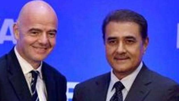 Gianni Infantino and AIFF President Praful Patel exchange greetings.(PTI)